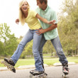 Stock Photo: Couple Wearing In Line Skates In Park
