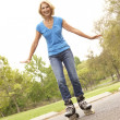 Stock Photo: Senior WomSkating In Park