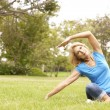 Senior Woman Exercising In Park — Stock Photo #4815864