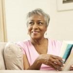Senior Woman Reading Book At Home — Stock Photo #4815898