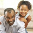 Grandfather And Granddaughter Playing Together At Home — Stock Photo