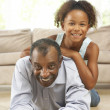 Grandfather And Granddaughter Playing Together At Home — Stock Photo #4815969