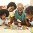 Family Playing Board Game At Home — Stock Photo #4815981