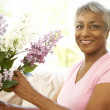 Senior Woman Flower Arranging At Home — Stock Photo #4815992