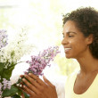 Stock Photo: WomFlower Arranging At Home