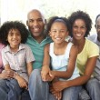 Stock Photo: Extended Family Relaxing On SofAt Home Together