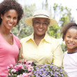 Senior Woman With Adult Daughter And Granddaughter Gardening Tog — Stock Photo #4816040