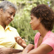 Senior Woman Being Consoled By Adult Daughter — Stockfoto