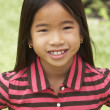 Stock Photo: Portait Of Smiling Young Girl Outdoors