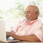 Senior Man Using Laptop At Home — Stock Photo