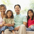 Young Family Relaxing On Sofa At Home — Stock Photo