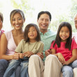 Extended Family Relaxing On Sofa At Home Together — Stock Photo #4816183