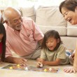 Grandparents And Grandchildren Playing Board Game At Home — Stock Photo