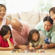 Extended Family Group Playing Board Game At Home — Stock Photo #4816204