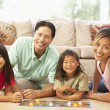 Stock Photo: Family Playing Board Game At Home