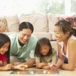 Family Playing Board Game At Home — Stock Photo #4816206