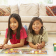 Stock Photo: Two Children Playing Board Game At Home