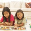 Two Children Playing Board Game At Home — Stock Photo #4816213