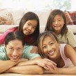 Young Family Relaxing At Home — Stock Photo