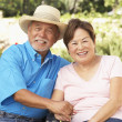 Senior Couple Relaxing In Garden Together — Stock Photo #4816260