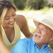 Senior Man With Adult Daughter In Garden - Stockfoto