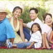 Extended Family Group Relaxing In Garden — Stock Photo #4816301