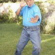Senior Man Doing Tai Chi In Garden — Stock Photo #4816308