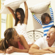 Young Family Having Pillow Fight In Bedroom — Stock Photo