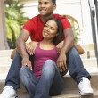 Young Couple Sitting On Steps Of Building — Stock Photo #4816346