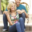 Young Couple Sitting On Steps Of Building — Stock Photo #4816364