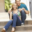 Young Couple Sitting On Steps Of Building — Stock Photo