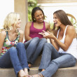Three Girlfriends Sitting On Steps Of Building — Stock Photo #4816394