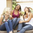 Three Girlfriends Sitting On Steps Of Building — Stock Photo #4816396