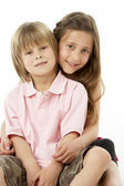 Two Children Sitting with each other in Studio — Stock Photo