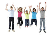 Group of Teenage Friends Jumping in Studio — Stock Photo