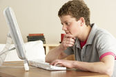 Teenage Boy in Thought Studying at Home — Stock Photo