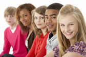 Studio Portrait Of Five Teenage Friends Standing In Line — Stock Photo
