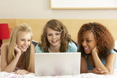 Group Of Three Teenage Girls Using Laptop In Bedroom — Stock Photo