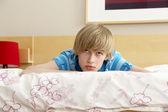 Teenage Boy In Bedroom Looking Sad — Stock Photo