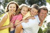 Family having fun in countryside — Stock Photo