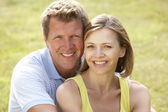 Middle aged couple having fun in countryside — Stock Photo