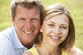 Close up of middle aged couple outdoors — Stock Photo
