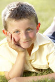 Portrait of young boy in countryside — Стоковое фото