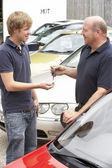 Young man collecting new car — Stock Photo