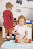 Two Young Children Playing Together at Montessori/Pre-School — Stock Photo