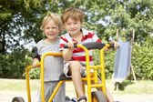 Two Young Boys Playing on Bike — Stock Photo
