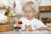 Adult Helping Young Children at Montessori/Pre-School — Stock Photo