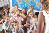 Montessori/Pre-School Class Listening to Teacher on Carpet — Stockfoto
