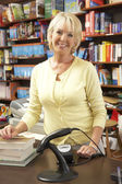 Female bookshop proprietor — Stock Photo