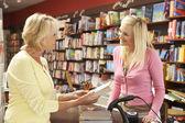 Female customer in bookshop — Stock Photo